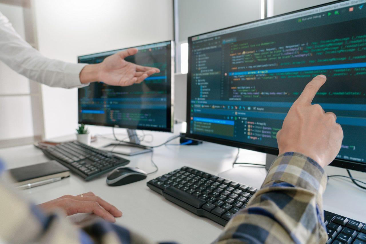 Pensive programmer working on desktop pc programming code technologies or website design at office Software Development Company